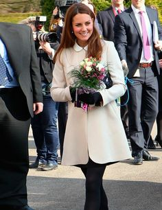 Kate Middleton wears a SS13 Goat Redgrave cream coat and a Topshop shift dress,