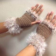 Hand made (crocheted) Fingerless mitts - by seller Cozy, soft fingerless mittens, with fun fur at wrist and hand end.   Dressy or not. Your choice, but definitely an eye catcher. Done in light brown with beige and lite brown trim Accessories Gloves & Mittens