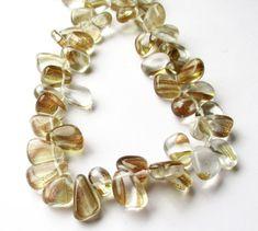 $8.00 #Rutilated Quartz Beads Sparkling Golden Smooth by BijiBijoux https://www.etsy.com/listing/215231149/rutilated-quartz-beads-sparkling-golden