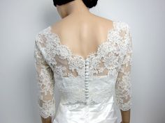 So pretty and an easy way to dress up a simple gown.   Vneck ivory Alencon Lace bolero jacket Bridal Bolero by alexbridal