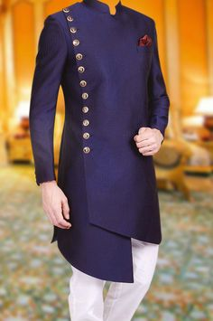 Flaunt your charm with extremely elegant navy blue side cut sherwani. The sherwani features magnificent buttons on one side with detailings and an exquisite pocket square that will make you look positively radiant. Mens Wedding Wear Indian, Sherwani For Men Wedding, Wedding Dresses Men Indian, Wedding Dress Men, Wedding Men, Wedding Suits, Formal Wedding, Wedding Hijab, Sherwani Groom