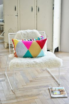 harlequin flipped over by wood & wool stool, via Flickr