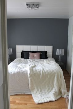 Bedroom gray walls with white comforter and curtains