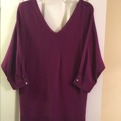 Purple sweater with silver buttons Beautiful WHBM purple sweater. Low neck line silver buttons go down the back. Also on the arms 3 quarter sleeves. Wore it for Easter. Smoke and pet free home. Perfect for spring! White House Black Market Sweaters