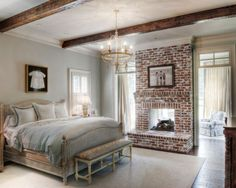 bedroom with sitting room and brick fireplace