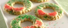 Relish these citrusy Christmas wreath cookies decorated with sprinkles – tasty dessert that can be stored for holiday treats.