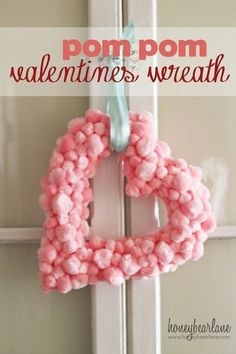 Easy Valentine's Pom Pom Wreath...this is so cute and fluffy, it reminds me of cotton candy, love it!