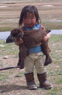 Mongol girl with little goat......MONGOL Culture (using PIC) | Steppe History Forum