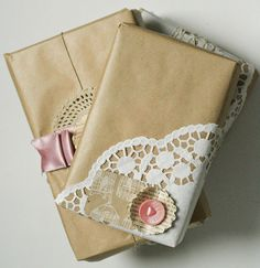 Wrap gifts in brown kraft paper then embellish either doilies, photos, etc #giftwrap #doily #brownpaper