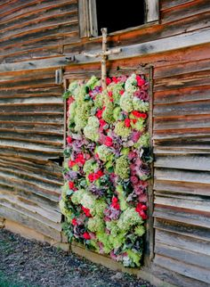 floral wall used as a backdrop during the ceremony