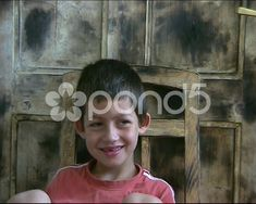 Stock video footage A small boy sits on grunge wooden chair in front of the door with a tanned paint, and talking - when he smiles, you can see that he is missing a tooth. Free Footage, Stock Footage, Audio Track, Small Boy, Stock Video, Shots, Portrait, Finger, Headshot Photography