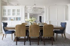Elegant dining room features a tiered crystal droplets chandelier, Robert Abbey Bling Chandelier, ...