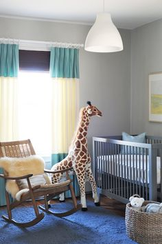 the grey walls and crib and blue curtains, blue rug. Simple design, not overly themey #baby room, #nursery