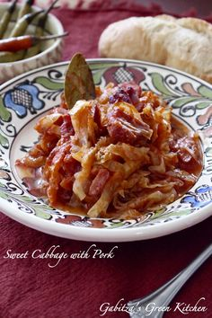 Sweet Cabbage with Pork- a delicious dish for the entire family- Romanian traditional- served with crusty bread, sour cream and hot peppers