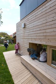 Kindergarten Rohrendorf - boxed seating and child-scaled sliding windows - connects outside and inside while creating a wee space for reflection.
