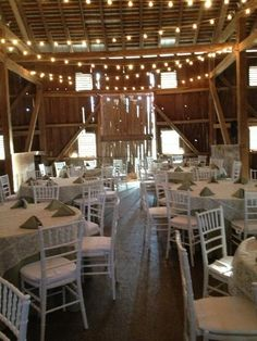 Pretty tables and a string of lights add instant romance to this rustic and historic wedding venue. {Rockland Farm Weddings}