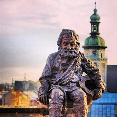A monument to a chimneysweep. The roof of the House of Legends. Lviv, Ukraine