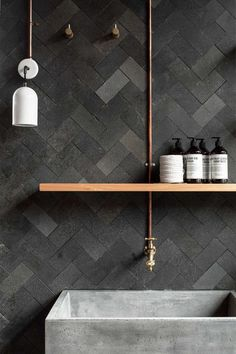 Herringbone wall tiles. Concrete and colors.