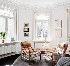 swedish space. / sfgirlbybay living room. leather. dark floors and bright white.