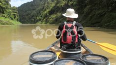 Man canoeing on a big river - Stock Footage | by JahnProductions