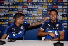 Lorenzo Insigne (L) and Eder of Italy joking during a press conference at Casa Azzurri on June 10, 2016 in Montpellier, France.