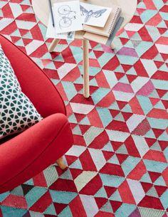 Teppich Mit Einem Muster In Rot Orange Und Grau