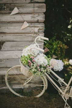 Blush Pink and Mint Rustic DIY Wedding. Ok I need an old bike with a big basket. I could rent it out for weddings :-)