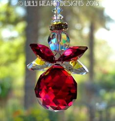 Suncatcher m/w Swarovski Crystal Bordeaux Red Angel with AB and Red Wings Lilli Heart Designs Beaded Christmas Ornaments, Christmas Angels, Snowman Ornaments, Christmas Tree, Crystal Beads, Swarovski Crystals, Beaded Angels, Angel Crafts, Hanging Crystals