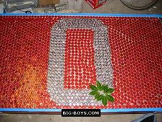 Ohio State bottle cap table...I wouldn't use OSU obviously, but this is a cool idea!