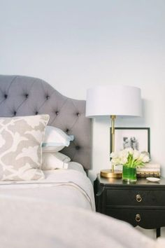 Grey headboard, black night tables, gold accents