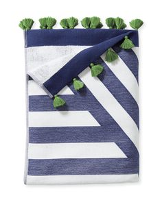 We've designed a beach towel that makes a splash in every way, especially with geometric stripes and playful pop-color tassels. It's woven from premium Turkish cotton with textural jacquard on one side and soft looped terry on the other. And the generous size and weight offer a luxury and practicality you'll never stop appreciating – leave one in your car for impromptu picnics.