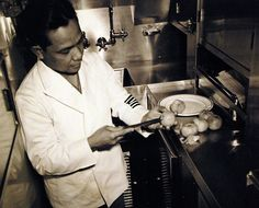 80-G-41801:   Life aboard a U.S. submarine.  In the wardroom kitchen, an officer's steward fixes tomatoes for a salad.     Photographed June 8, 1943.  U.S. Navy Photograph, now in the collections of the National Archives.  (2016/05/10).