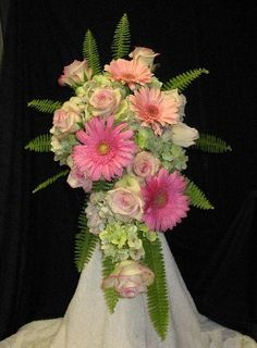 Create a Bouquet - Step by step photo tutorial with product list.  Find all the professional florist supplies needed to make your own wedding flowers