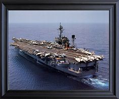 This aircraft carrier USS Navy ship constellation aviation framed art poster will be a decorative piece for your wall. You'll be proud to hang this framed art on the walls of your home. Its wooden golden frame accentuates the poster mild tone. The frame is made from solid wood measuring 18x22 inches with a smooth gesso finish. This framed poster includes a wire hanger on the back for easy display.