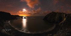 Playa del Silencio Panoramic photograph taken on the beach of silence minutes before the moon put the horizon.  Photography by Glendor Díaz Suárez