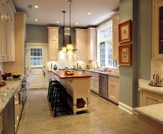 Cozy, happy colors. White cabinets, and light counter-tops, with light blue walls, copper accents.