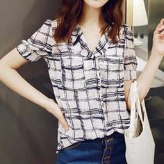 A painterly check pattern and a lightweight semi-sheer chiffon construction result in this playful blouse suitable for both play and work. Slightly puffed sleeves grant a sweet finish.