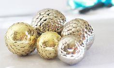 Create this stylish centerpiece by covering foam balls with metallic push pins.