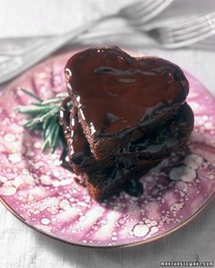 Rich Chocolate Heart Cakes | Martha Stewart Living, February 2000 | You will need twelve 3 3/4-inch heart molds or tart pans with removable bottoms to make individual chocolate cakes. | From: marthastewart.com