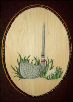 This unique Golf Embroidery Balsa Wood Art combines the warmth of wood with the raised texture of 9 different thread colors and 13,555 stitches. The design was machine embroidered into a sheet of balsa wood, then cut and mounted on an oak stained 7 x 9 x 1 plaque. The black leather braided trim was added before a clear protective, non-yellowing acrylic matte finish was applied. A brass hanger is attached to the backside making it ready for hanging.    Balsa Wood Embroidery is very uncommon…