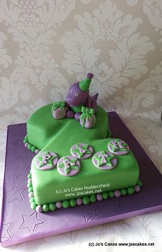 2 shaped cake with hand made Barney the dinosaur.