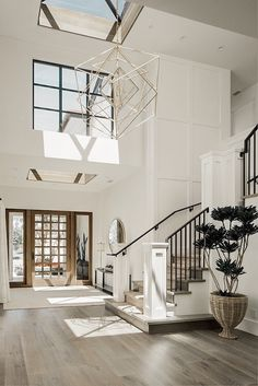 Farrow and Ball All White Foyer Two story foyer with skylight and grid board and. - interior design creative Farrow and Ball All White Foyer Two story foyer with skylight and grid board and… - Home Decoraiton Interior Design Minimalist, Home Interior Design, White House Interior, Interior Design For Living Room, Interior Architecture, Modern Interior Doors, Hotel Lobby Interior Design, Natural Modern Interior, Staircase Interior Design