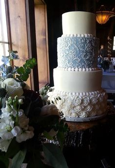 Lace on this was to match the brides dress. Lace wedding cake. Lace tiered wedding cake. Rosette Wedding Cake. Wedding Planning. Wedding Trends. Personalized Wedding. Trendy Wedding. Blue and White Wedding Cake.