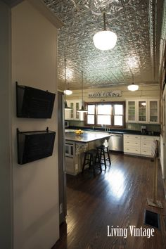 <3<3<3 this kitchen!!!! Look at the tin ceiling, wood floors, beadboard backsplash and wood planked wall. The lights are incredible. Can ya tell I LOVE it ALL!!!!