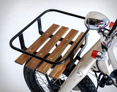 """The talented team at Deus Customs have created the perfect ride for hitting the beach in style. Based on a 1974 Honda Super Cub C70, the Sea Sider"""" is a surf commuter built for the itinerant surfer, it features the engine from a 1995 Honda Astra for"""