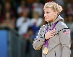 Ohio native and Gold medallist Kayla Harrison listens to her national anthem during awards ceremony for women's -78kg judo competition at London 2012 Olympic Games