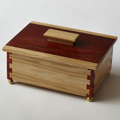 Hickory and padauk keepsake box with cornerpost dovetail joints.