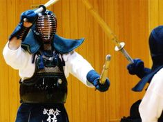 A girl using the Nito (two sword) technique in Kendo.