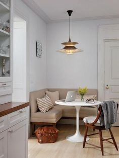 Once home to an outdated galley kitchen, this NYC apartment got a major overhaul that included a fantastic new kitchen with a quaint place to dine that doesn't take up too much space. This corner seating area includes a custom banquette that easily goes from breakfast nook to home office.
