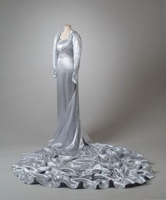 Ice blue satin wedding gown, 1938 I like this more for the colour of it.